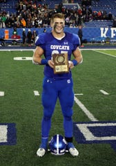 Covington Catholic's Michael Mayer poses with his MVP Award from the KHSAA 5A state championship final Dec. 7, 2019. Covington Catholic defeated Frederick Douglass 14-7.