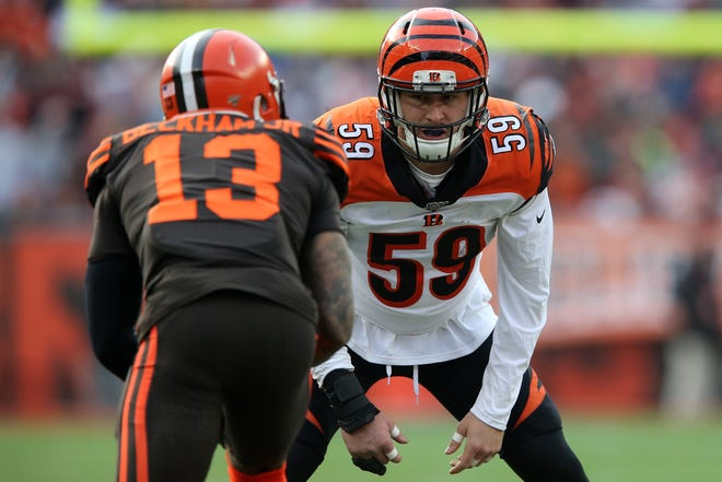 Cincinnati Bengals outside linebacker Nick Vigil (59) lines up to defend against Cleveland Browns wide receiver Odell Beckham (13) in the first quarter during a Week 14 NFL football game, Sunday, Dec. 8, 2019, at FirstEnergy Stadium in Cleveland.