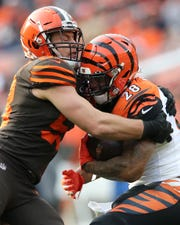 Cleveland Browns outside linebacker Christian Kirksey (58) tackled Cincinnati Bengals running back Joe Mixon (28)  in the second quarter during a Week 14 NFL football game, Sunday, Dec. 8, 2019, at FirstEnergy Stadium in Cleveland.