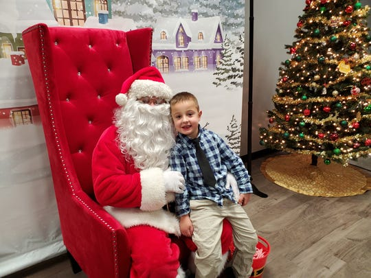 Michael Grzankowski sits on Santa's lap.
