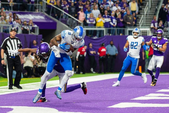Detroit Lions receiver Kenny Golladay catches a touchdown during the fourth quarter against the Minnesota Vikings, Sunday, Dec. 8, 2019, in Minneapolis.