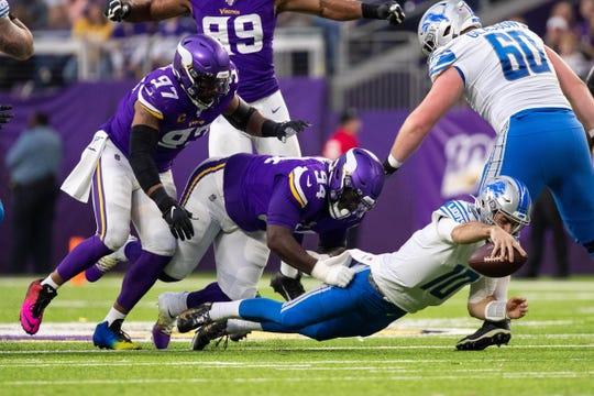 Minnesota Vikings defensive lineman Jaleel Johnson (94) sacks Detroit Lions quarterback David Blough in the second quarter Sunday, Dec. 8, 2019, in Minneapolis.