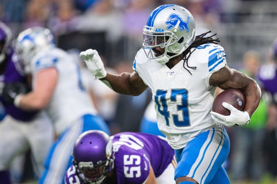 Detroit Lions' Bo Scarbrough runs the ball during the first quarter against the Minnesota Vikings, Sunday, Dec. 8, 2019, in Minneapolis.