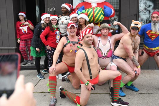 Participants pose outside Briggs Detroit bar at the end of the annual Detroit Santa Speedo Run in Detroit on Sunday, December 8, 2019.