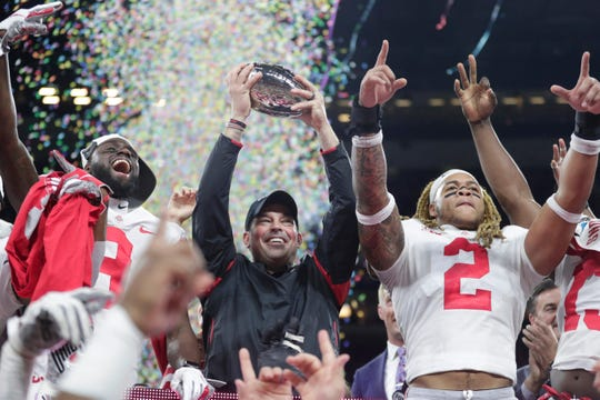 Ohio State coach Ryan Day celebrates after Ohio State defeated Wisconsin in the Big Ten championship.