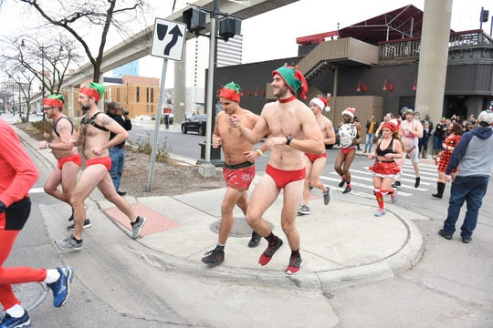 Participants run along Jefferson Avenue for the start of the Detroit Speedo Run on Sunday, December 8, 2019. Max Ortiz, The Detroit News