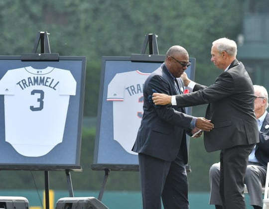 Alan Trammell greets longtime double play partner Lou Whitaker after Whitaker spoke during a ceremony to retire Trammell's jersey at Comerica Park in August 2018.