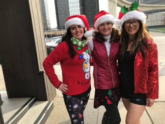 Erin Patrick, Lisa Whalen, and Jennifer Fleming, all of Novi, pose before their mile-long run through the streets of downtown Detroit.