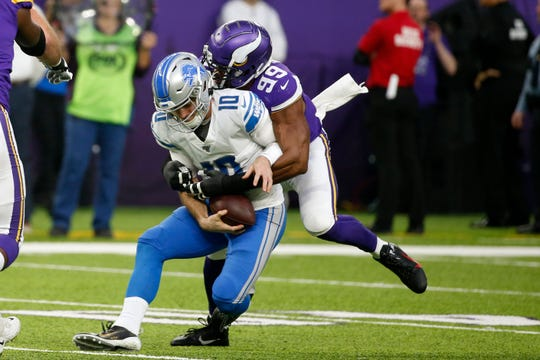 Detroit Lions quarterback David Blough is sacked by Minnesota Vikings defensive end Danielle Hunter.