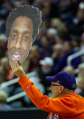 Mark Martin of Haubstadt, Ind., holds a sign of Evansville's DeAndre Williams (13) at the UE vs Miami University game at the Ford Center in Evansville, Saturday, Dec. 7, 2019.