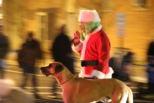 "The Grinch and his dog, Max, were spotted marching in the ""Holly Jolly Parade"" on Saturday night."