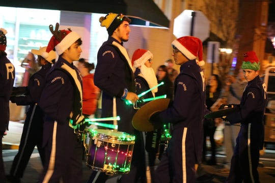 "The Fremont Ross Marching Little Giants lit the night along Front Street during the ""Holly Jolly Parade"" on Saturday night."