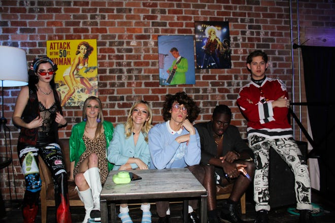 Models sport thrifted clothing at DWF x Thrift CLub fashion show on Thursday Dec. 5 at GVO.