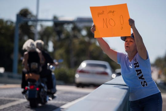 About a dozen protesters urging rejection of annexation of 4 1/2 acres of land at the entrance to Matlacha by Cape Coral staged a protest Sunday. On Monday, they won, as the Cape City Council rejected the annexation on a 5-2 vote. But Cape Coral still owns the land, and may sell it. If a developer buys it, land-use regulations will be decided by county commissioners.