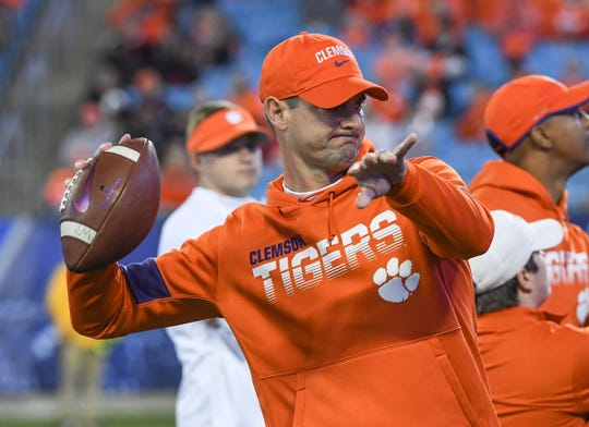 Clemson wide receiver coach Jeff Scott throws to a receiver before the ACC Championship game Saturday, Dec. 7, 2019.