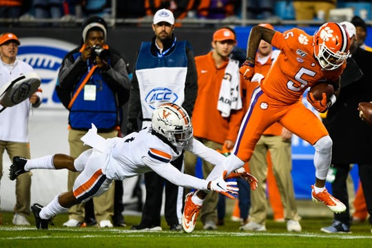 Clemson wide receiver Tee Higgins (5) slips past a UVA defender to score a touchdown during the ACC Championship game on Saturday, Dec. 7, 2019.