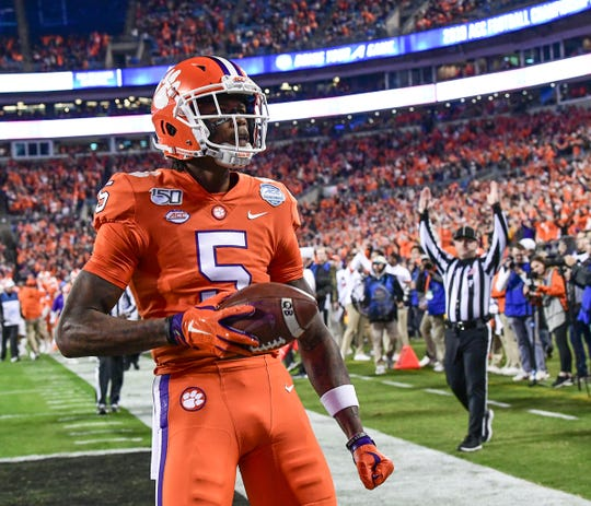 Clemson wide receiver Tee Higgins (5) celebrates his 19-yard touchdown during the first quarter of the ACC Championship game at the Bank of America Stadium in Charlotte Saturday, Dec. 7, 2019.