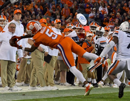 Clemson wide receiver Tee Higgins (5) reels in an incredible catch on the sideline during the second quarter of the ACC Championship game on Saturday, Dec. 7, 2019.