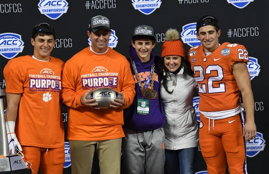 Drew Swinney, left, Clemson Head Coach Dabo Swinney, Clay Swinney, Kathleen Swinney, and Will Swinney after the Tigers beat Virginia 62-17 in the ACC Championship game at the Bank of America Stadium in Charlotte Saturday, Dec. 7, 2019.