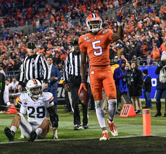 Clemson wide receiver Tee Higgins (5) signals first down near the end zone and Virginia safety Joey Blount (29) during the third quarter of the ACC Championship game at the Bank of America Stadium Saturday, Dec. 7, 2019.