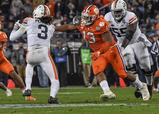 Clemson defensive lineman Tyler Davis(13) pressures Virginia quarterback Bryce Perkins (3) during the second quarter of the ACC Championship game at the Bank of America Stadium in Charlotte Saturday, Dec. 7, 2019.