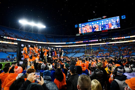Clemson players and coaches celebrate after beating Virginia during the ACC Championship game at the Bank of America Stadium Saturday, Dec. 7, 2019.