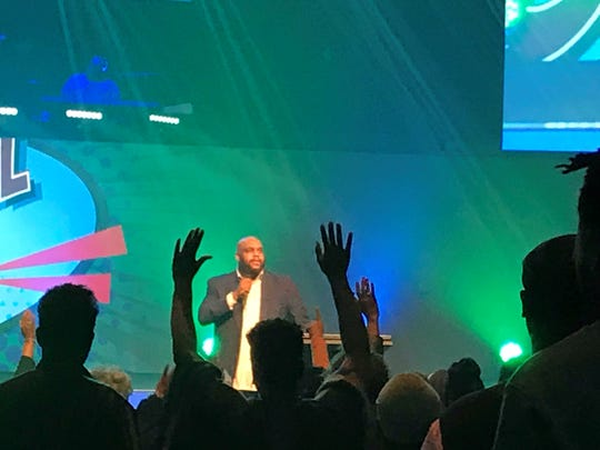 Pastor John Gray talks to congregation at Relentless Church on Sunday.