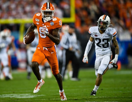 Clemson wide receiver Justyn Ross (8) catches a 59-yard touchdown pass against Virginia in the ACC Championship game on Saturday, Dec. 7, 2019.