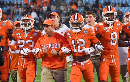 Clemson Head Coach Dabo Swinney and players walk together before the ACC Championship game Saturday, Dec. 7, 2019.