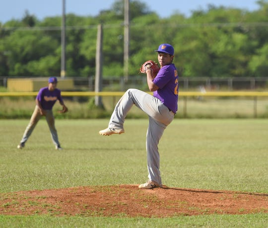 The George Washington Geckos' Jaren Gumataotao pitches in an IIAAG Baseball game in this Dec. 7 file photo. The third baseman was unanimously chosenas the Most Valuable Player of the 2019 Baseball League.