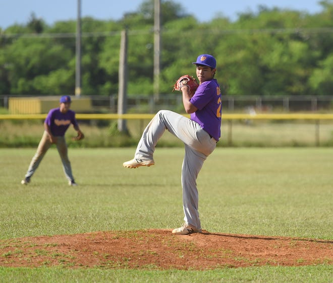 The George Washington Geckos' Jaren Gumataotao pitches in an IIAAG Baseball game in this Dec. 7 file photo. The third baseman was unanimously chosen as the Most Valuable Player of the 2019 Baseball League.