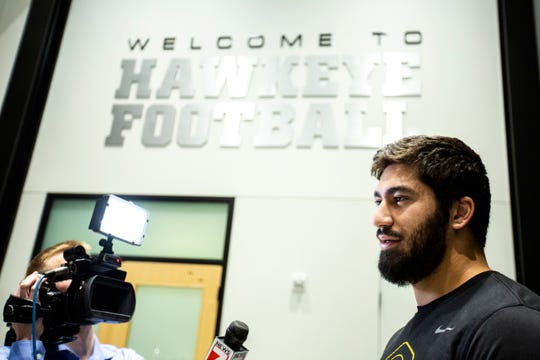 Iowa defensive end A.J. Epenesa talks with reporters during a press conference following the announcement of the Holiday Bowl destination, Sunday, Dec. 8, 2019 at the Hansen Football Performance Center in Iowa City, Iowa.