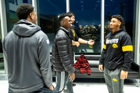 Iowa players Ihmir Smith-Marsette, from left, Michael Ojemudia, A.J. Epenesa and Geno Stone talk with each other during a press conference following the announcement of the Holiday Bowl destination, Sunday, Dec. 8, 2019 at the Hansen Football Performance Center in Iowa City, Iowa.