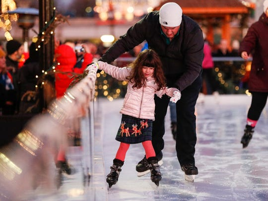 The annual Carmel Christkindlmarkt lit up downtown Carmel, Ind., on Saturday, Dec. 7, 2019. The Christkindlmarkt features ice skating, festive food, activities, shops and hot chocolate.