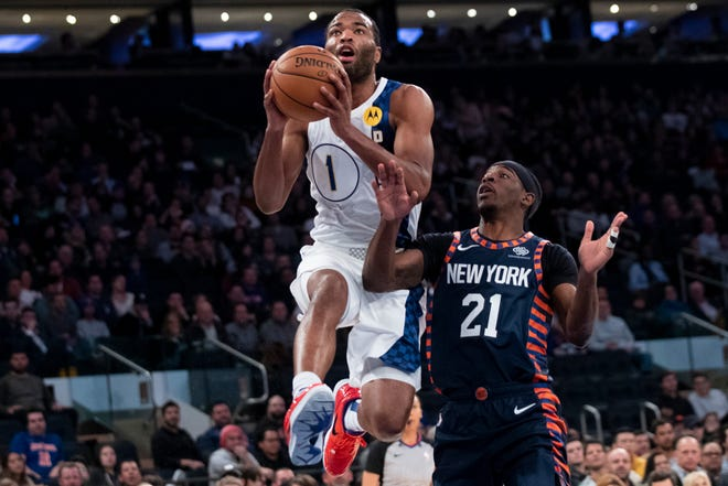 Indiana Pacers forward T.J. Warren (1) goes to the basket past New York Knicks guard Damyean Dotson (21) in the first half of an NBA basketball game, Saturday, Dec. 7, 2019, at Madison Square Garden in New York.