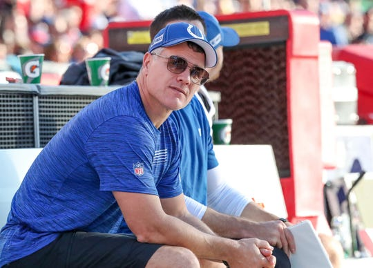 An injured Indianapolis Colts kicker Adam Vinatieri (4) watches the game against the Tampa Bay Buccaneers from the bench at Raymond James Stadium in Tampa, Fla., on Sunday, Dec. 8, 2019.