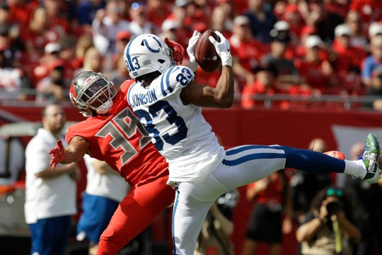 Indianapolis Colts wide receiver Marcus Johnson (83) beats Tampa Bay Buccaneers strong safety Andrew Adams (39) on a 46-yard touchdown reception during the first half of an NFL football game Sunday, Dec. 8, 2019, in Tampa, Fla.