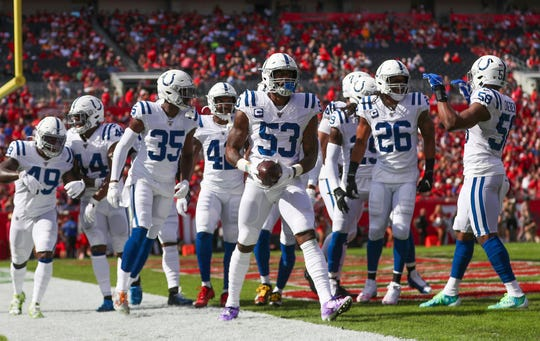 Indianapolis Colts outside linebacker Darius Leonard (53) celebrates an interception with teammates against the Tampa Bay Buccaneers at Raymond James Stadium in Tampa, Fla., on Sunday, Dec. 8, 2019.