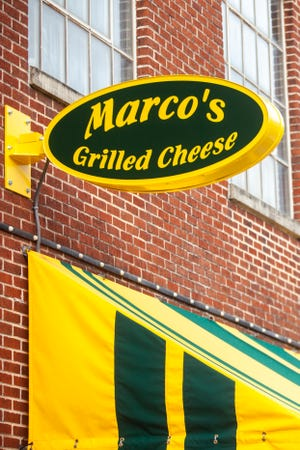 A signs for Marco's Grilled Cheese is pictured, Sunday, Dec. 8, 2019 along N. Linn Street in the Northside of Iowa City, Iowa.