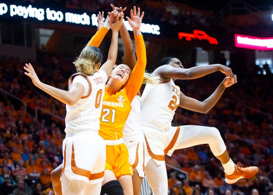 Tennessee's Lou Brown (21) gets caught in a scrum during the Lady Vols' basketball game against the University of Texas' Longhorns on Sunday, December 8, 2019 at Thompson-Boling Arena.