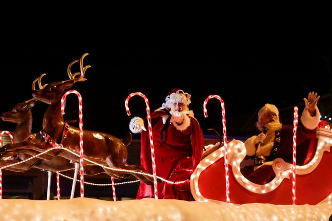 """Santa and Mrs. Claus ride along Main St. during Greater Lafayette's annual Christmas Parade, """"A Very Merry Main Street,"""" Saturday, Dec. 7, 2019, in Lafayette."""