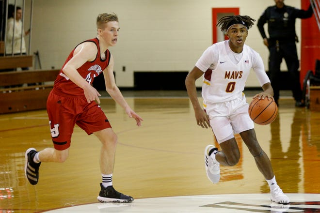 McCutcheon's Joe Phinisee (0) dribbles past Lafayette Jeff's Braxton Barnhizer (44) during the second quarter of the 2019 Franciscan Health Boys Hoops Classic championship, Saturday, Dec. 7, 2019, in Lafayette.
