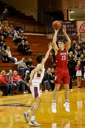 Lafayette Jeff's Brooks Barnhizer (13) goes up for three during the first quarter of the 2019 Franciscan Health Boys Hoops Classic championship, Saturday, Dec. 7, 2019, in Lafayette.