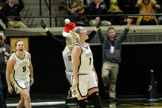 Purdue guard Karissa McLaughlin (1) celebrates after nailing a half-court buzzer beater during the second quarter of a NCAA women's basketball game, Sunday, Dec. 8, 2019 at Mackey Arena in West Lafayette.