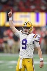 Dec 7, 2019; Atlanta, GA, USA; LSU Tigers quarterback Joe Burrow (9) react to a touchdown against the Georgia Bulldogs during the third quarter of the the 2019 SEC Championship Game at Mercedes-Benz Stadium. Mandatory Credit: John David Mercer-USA TODAY Sports
