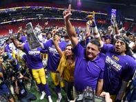 Dec 7, 2019; Atlanta, GA, USA; LSU Tigers head coach Ed Orgeron celebrates their 37-10 victory over the Georgia Bulldogs after the 2019 SEC Championship Game at Mercedes-Benz Stadium. Mandatory Credit: John David Mercer-USA TODAY Sports