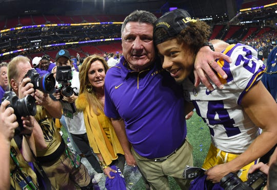 Dec 7, 2019; Atlanta, GA, USA; LSU Tigers head coach Ed Orgeron celebrates their 37-10 victory over the Georgia Bulldogs with LSU Tigers cornerback Derek Stingley Jr. (24) after the 2019 SEC Championship Game at Mercedes-Benz Stadium. Mandatory Credit: John David Mercer-USA TODAY Sports