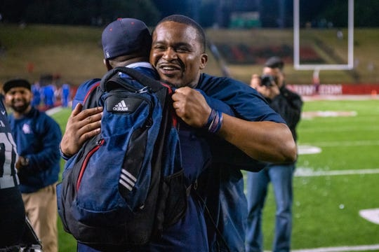 Lafayette Christian head coach Jacarde Carter celebrates his team's win after the game as the LCA Knights won the LHSAA Division III Football State Championship on Saturday.