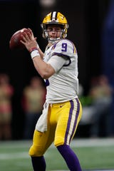LSU quarterback Joe Burrow (9) works against Georgia during the second half of the Southeastern Conference championship NCAA college football game, Saturday, Dec. 7, 2019, in Atlanta. (AP Photo/John Bazemore)