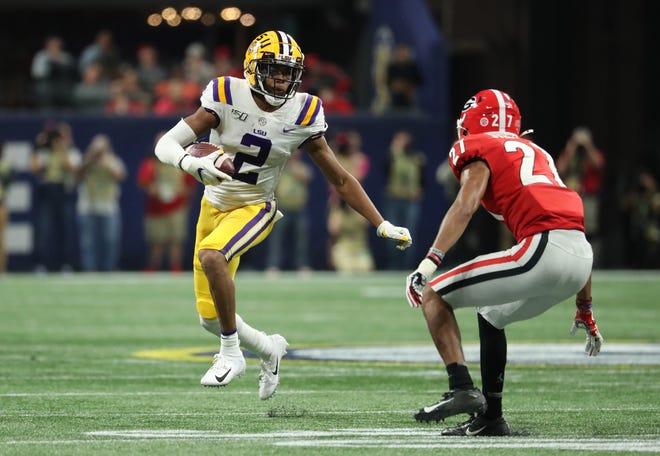 Dec 7, 2019; Atlanta, GA, USA; LSU Tigers wide receiver Justin Jefferson (2) makes a move against Georgia Bulldogs defensive back Eric Stokes (27) after a catch in the second half in the 2019 SEC Championship Game at Mercedes-Benz Stadium. Mandatory Credit: Jason Getz-USA TODAY Sports